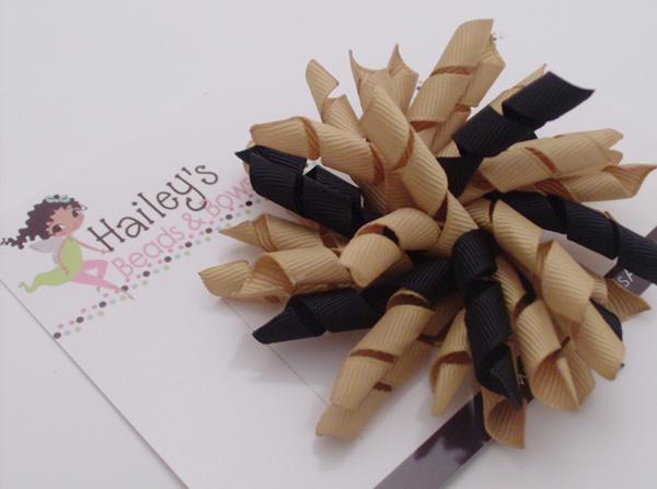 Geaux Saints Korker Hair Bow-New Orleans Saints Hair Bows, black and gold hair bows, korker hair bows, large hair bows, school hair bows, louisiana boutique, online hair bows, boutique hair bows